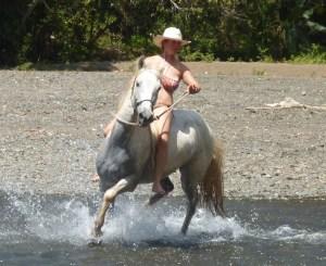 Intern Lara, riding Beau at Rio Tulin on the Jungle River Trek with Parelli instructor Nita Jo Rush, Feb 2013